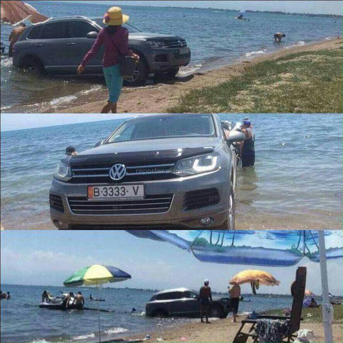 В озеро Иссык-Куль заехал Volkswagen Touareg, из которого выгрузили скутер <i>(фото)</i>