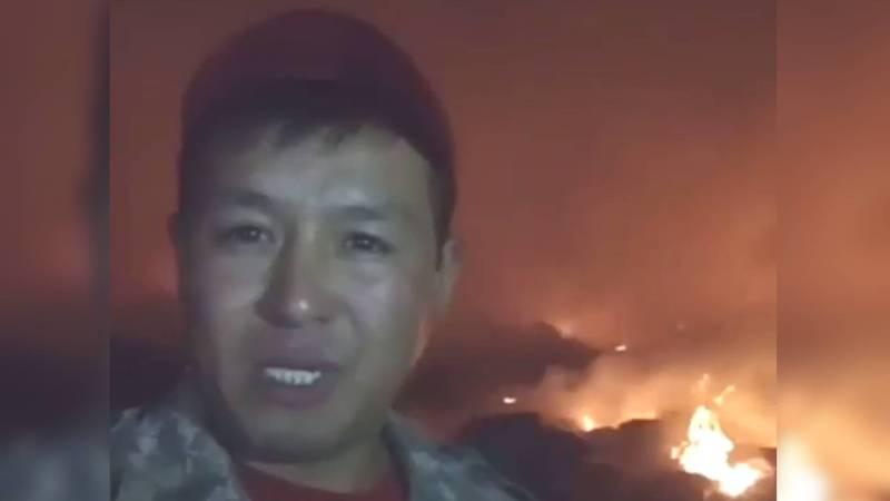 Житель села Искра снял видеообращение на фоне горящей мусорной свалки (видео)